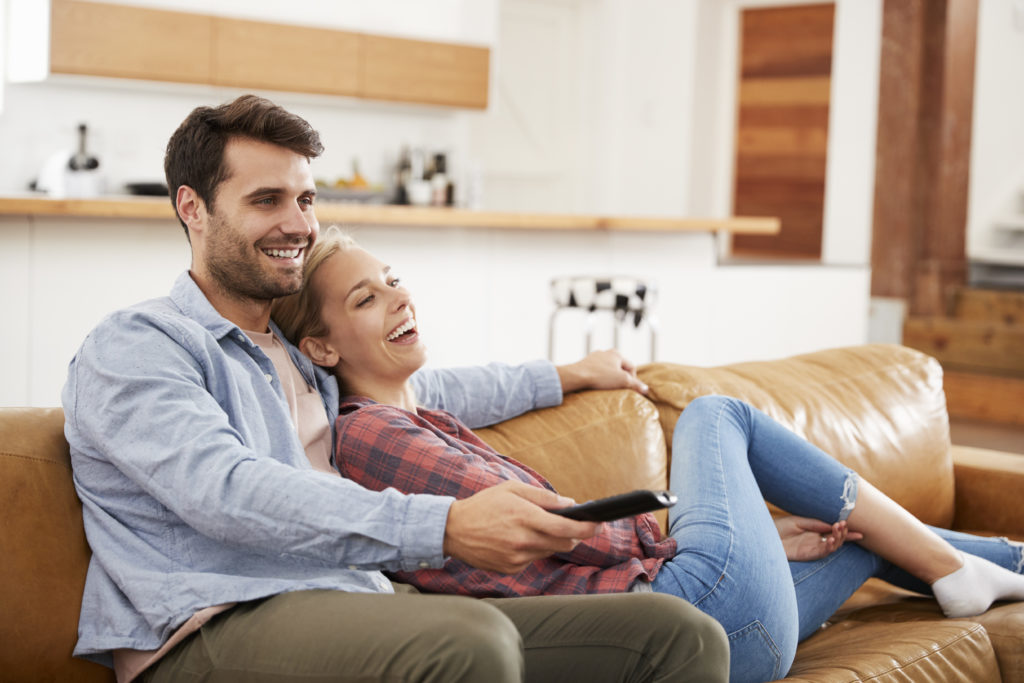 https://elements.envato.com/couple-sitting-on-sofa-watching-television-P3HG4ST