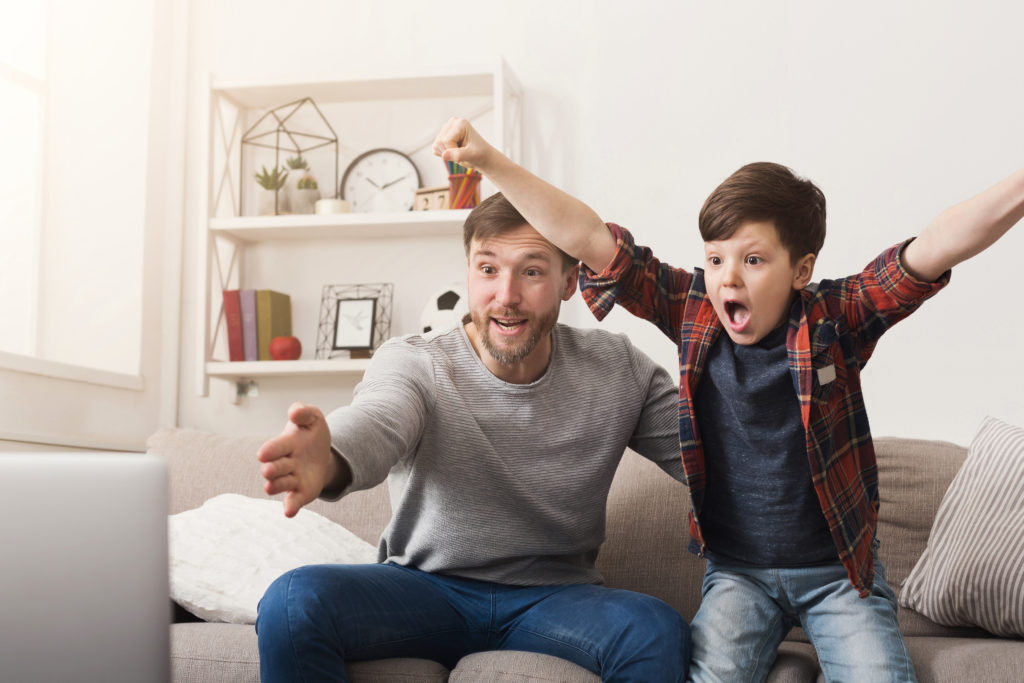 https://elements.envato.com/father-and-son-watching-football-on-tv-at-home-G9XJLHN
