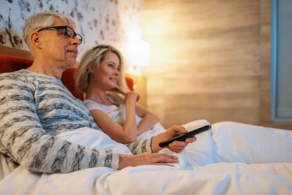 https://elements.envato.com/mature-love-couple-watching-tv-in-bedroom-6MB2YPN