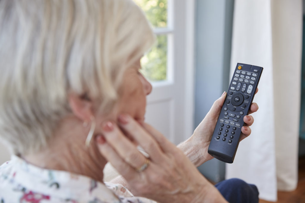https://elements.envato.com/senior-woman-using-tv-remote-control-over-P8GBNVZ