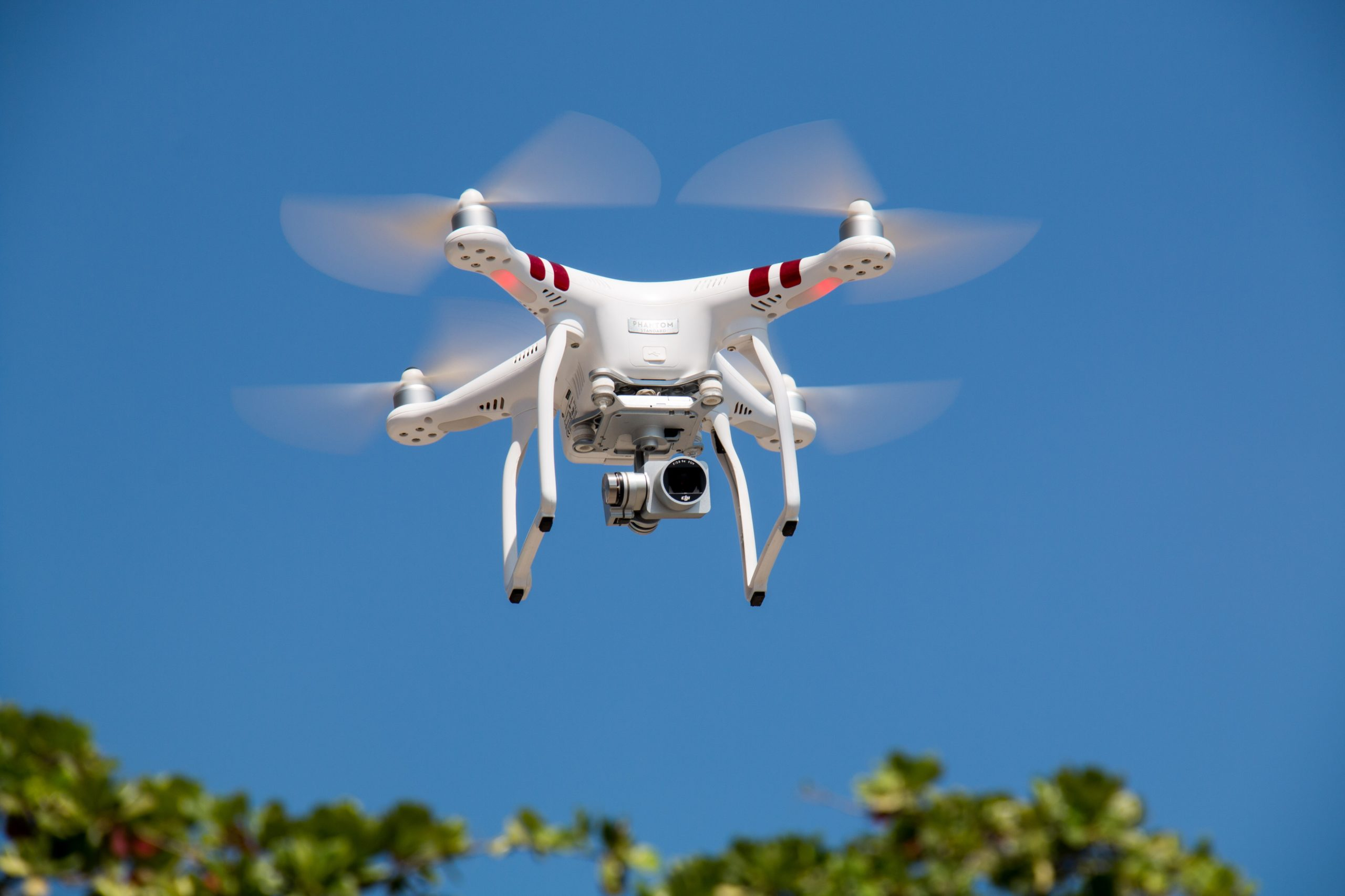 best drone under 50 https://www.pexels.com/photo/drone-flying-against-blue-sky-336232/