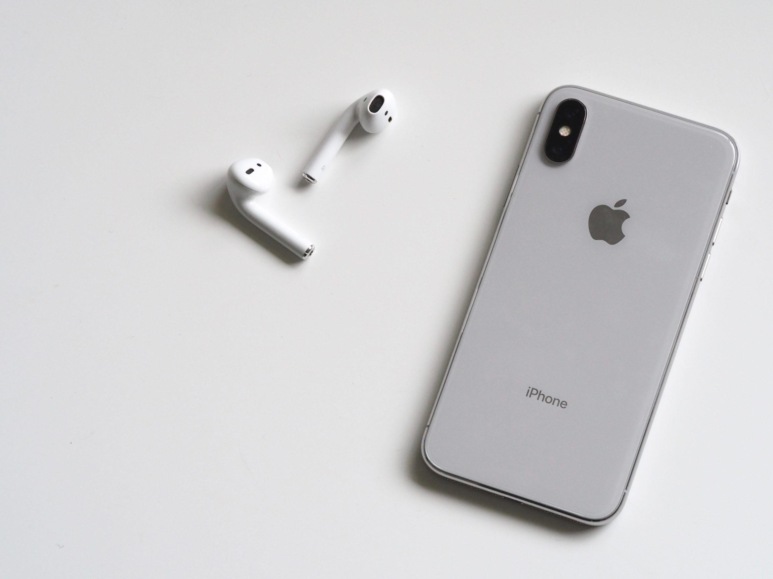 apple music keeps saying content not authorised https://www.pexels.com/photo/silver-iphone-x-with-airpods-788946/