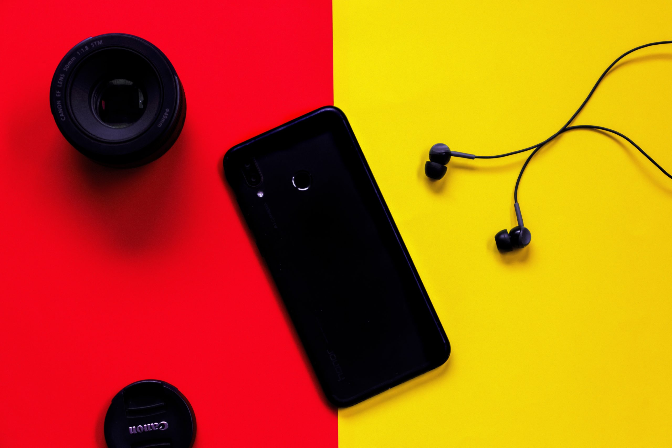 https://www.pexels.com/photo/black-smartphone-besides-earphones-and-camera-lens-2769274/