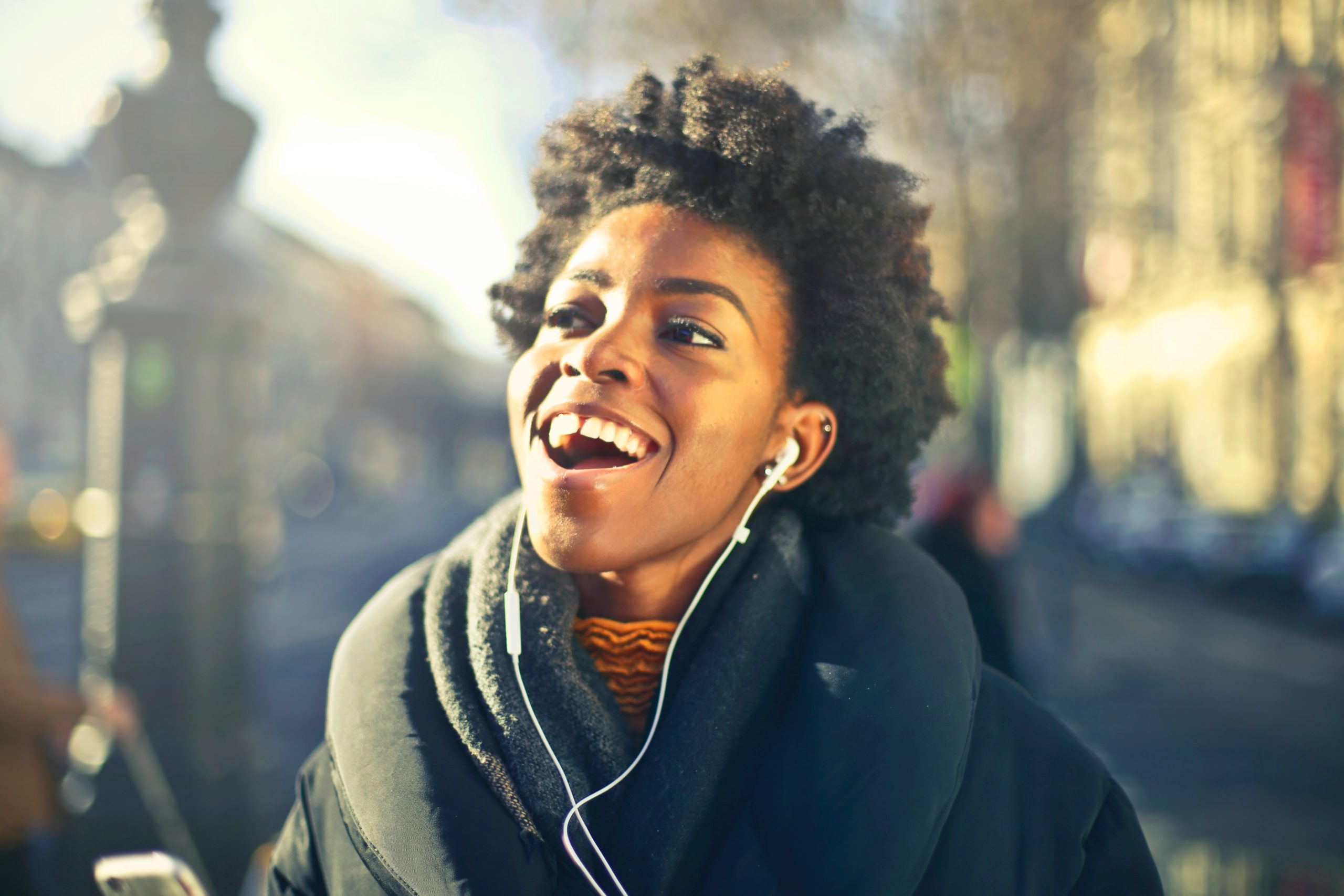 https://www.pexels.com/photo/close-up-photo-of-a-woman-listening-to-music-813940/