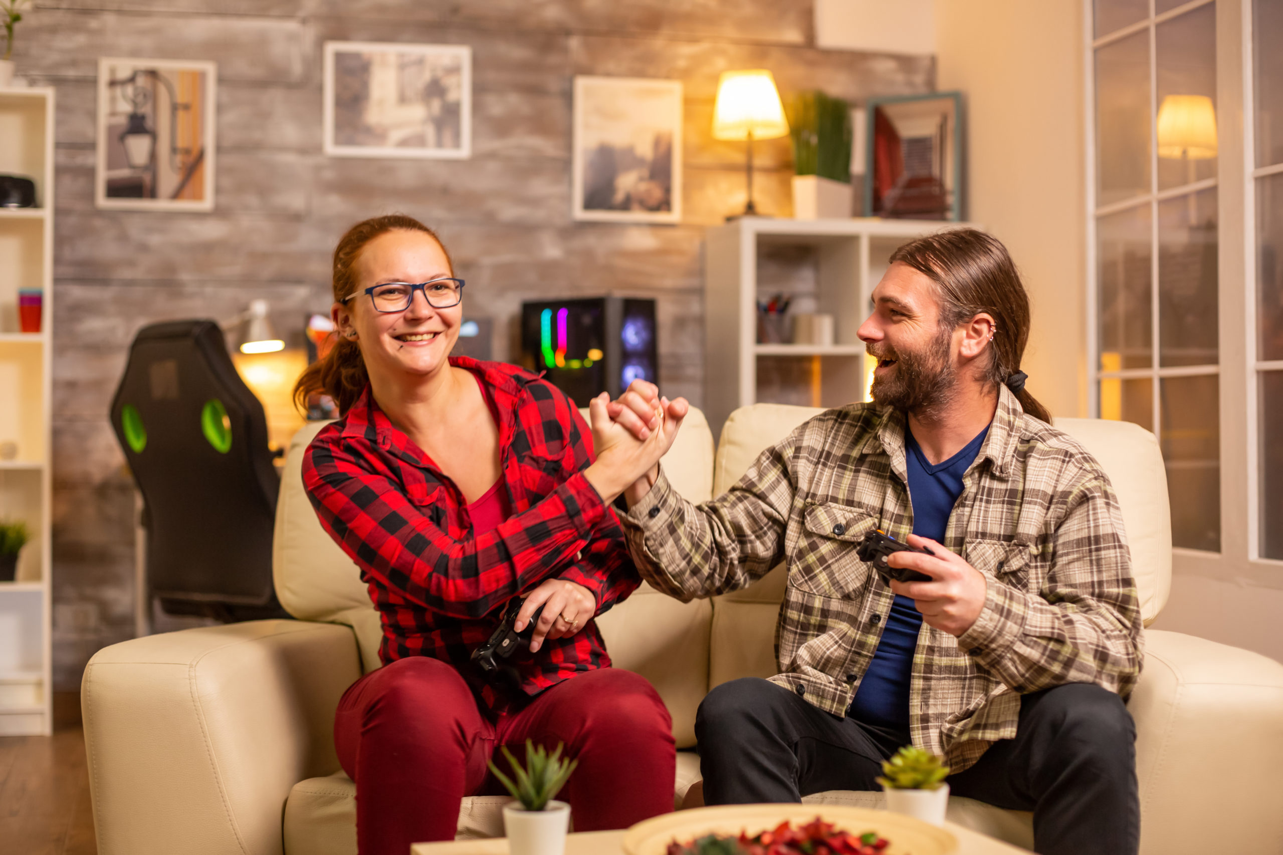 https://elements.envato.com/gamers-couple-playing-video-games-on-the-tv-with-XYDDYAQ