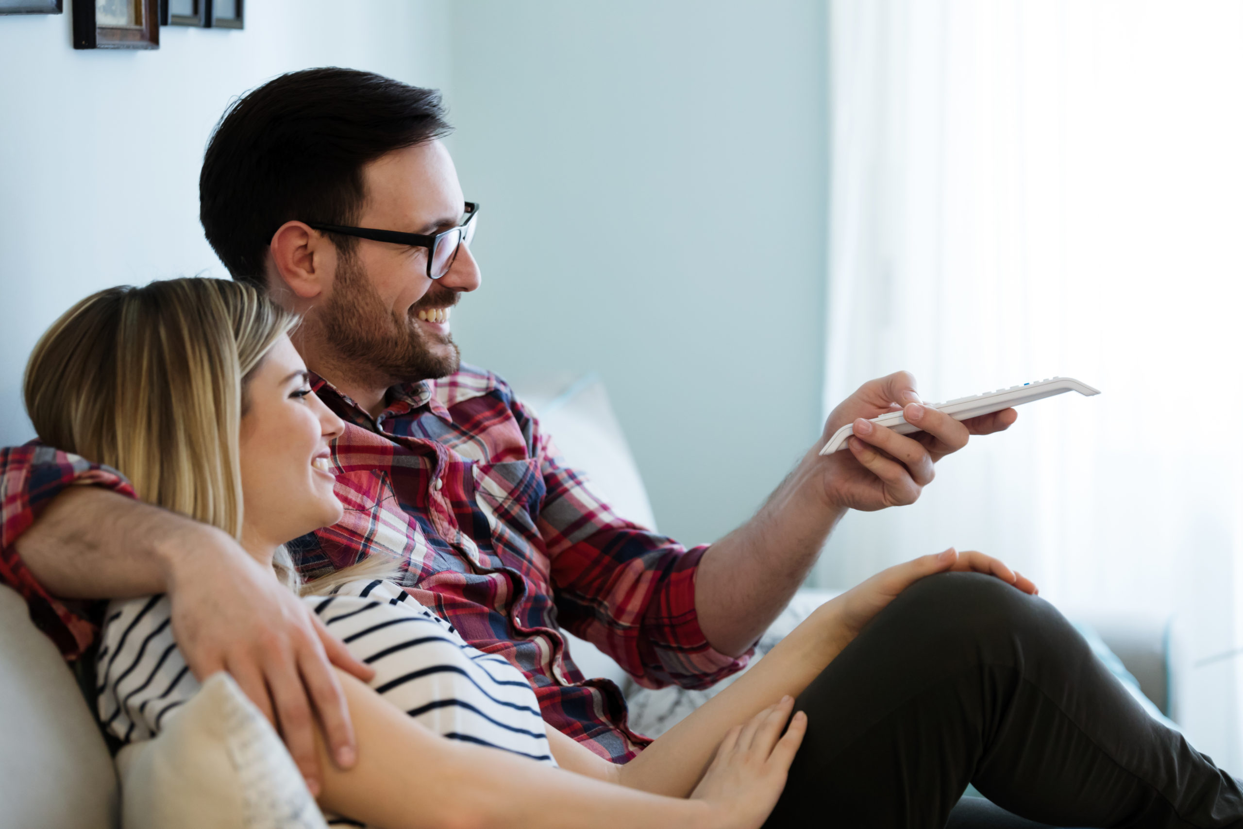 https://elements.envato.com/romantic-couple-watching-tv-at-home-RYD6AS4