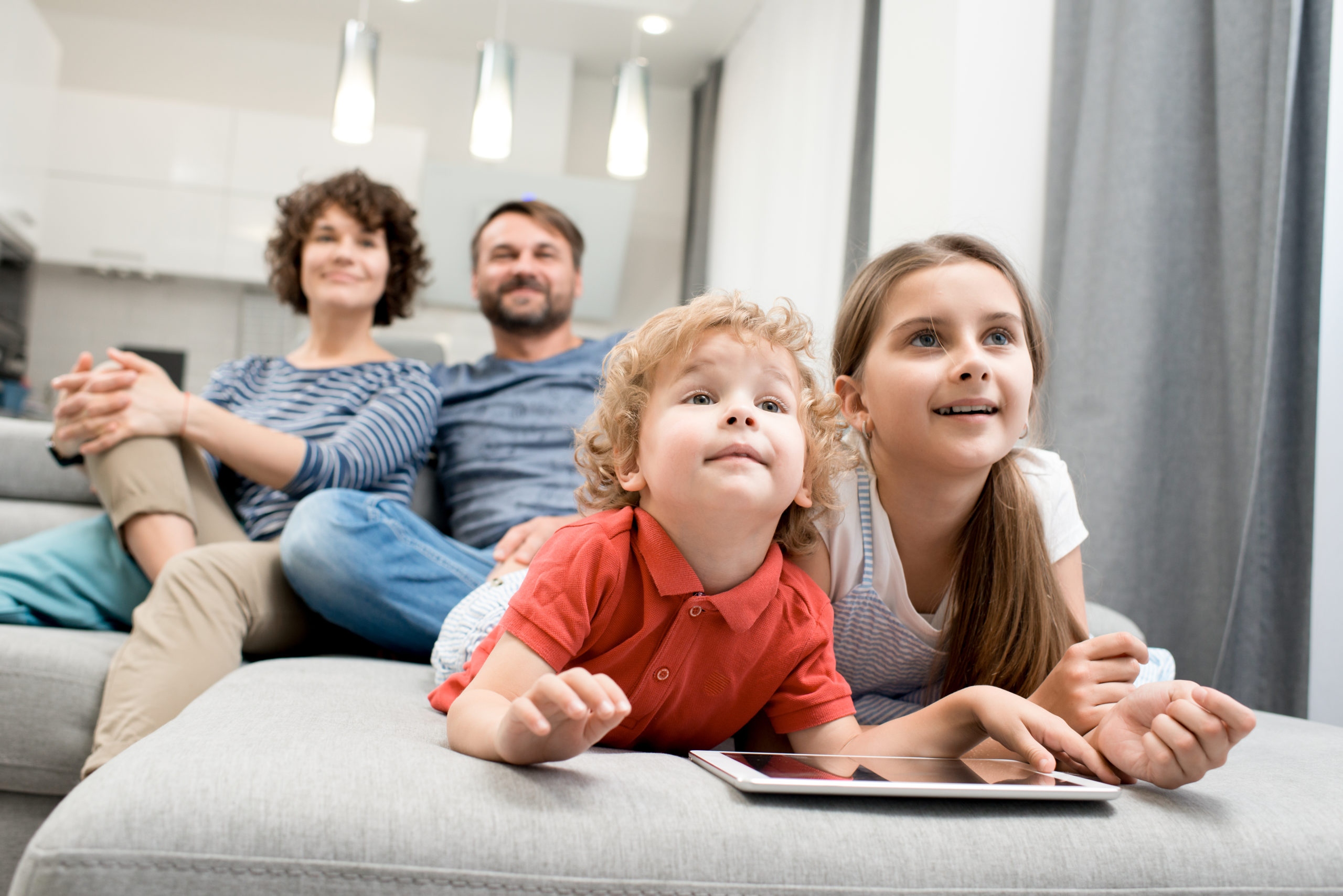 https://elements.envato.com/happy-family-in-living-room-MT8HL6F