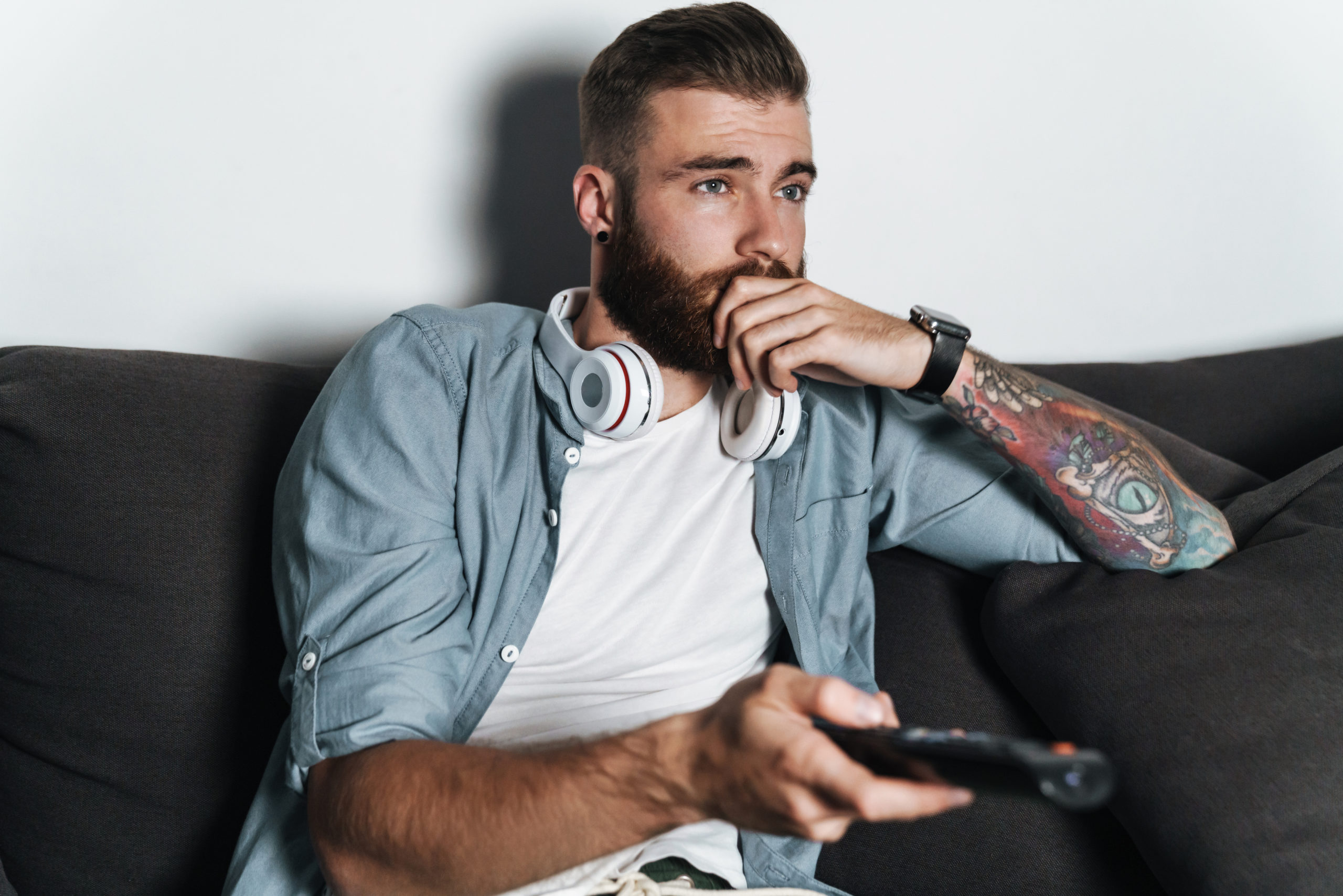 https://elements.envato.com/attractive-young-bearded-man-relaxing-on-a-couch-a-P4KWKYE