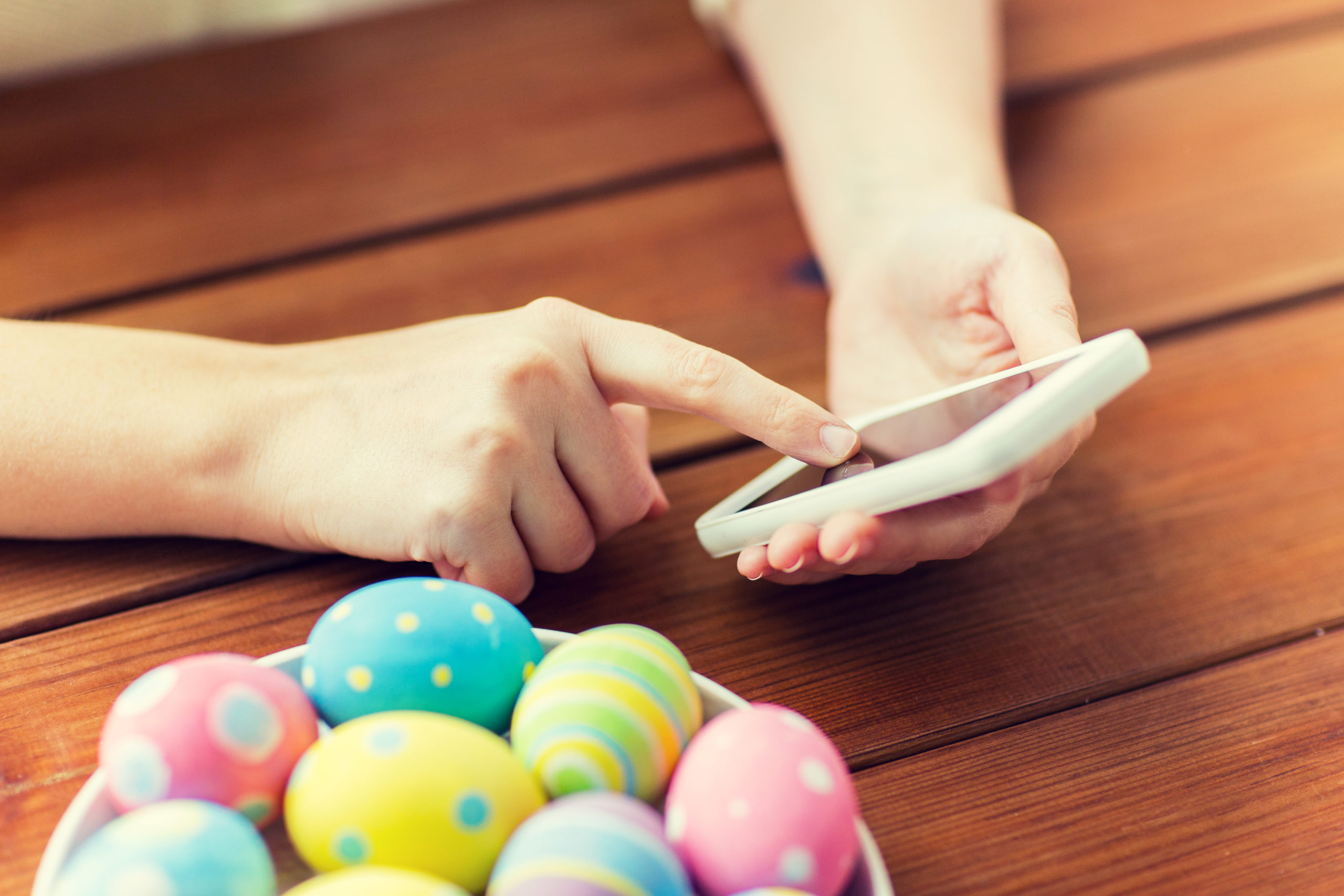 https://elements.envato.com/close-up-of-hands-with-easter-eggs-and-smartphone-PKU87UJ