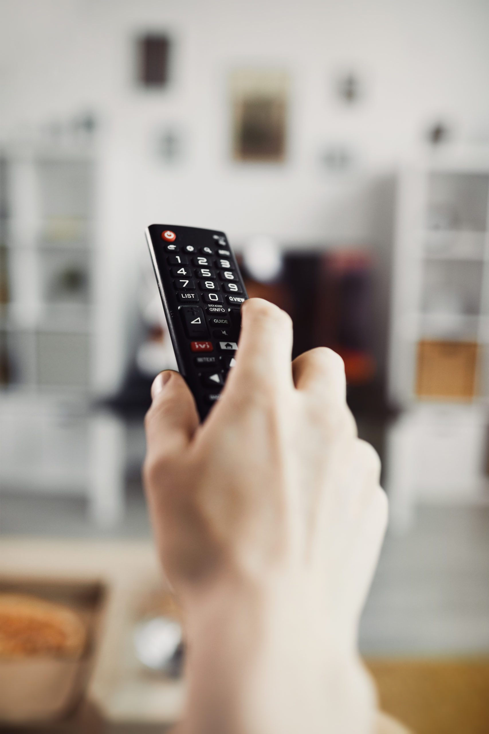 Retune Freeview lost channels https://elements.envato.com/closeup-hand-holding-tv-remote-BQWR5ZX