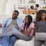 https://elements.envato.com/father-sitting-on-sofa-watching-tv-with-teenage-da-PLJH7CK