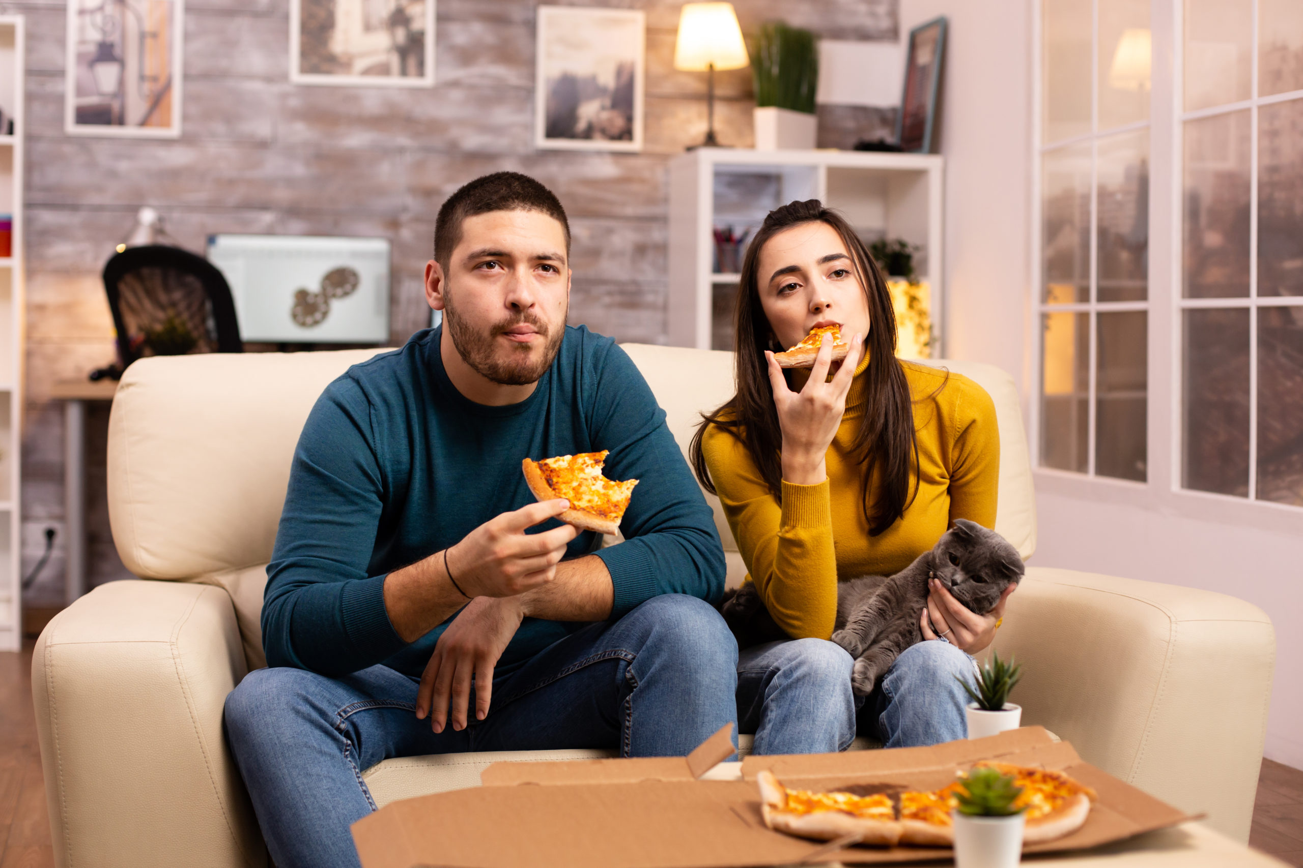 https://elements.envato.com/gorgeous-young-couple-eating-pizza-while-watching--VGVH9Q6