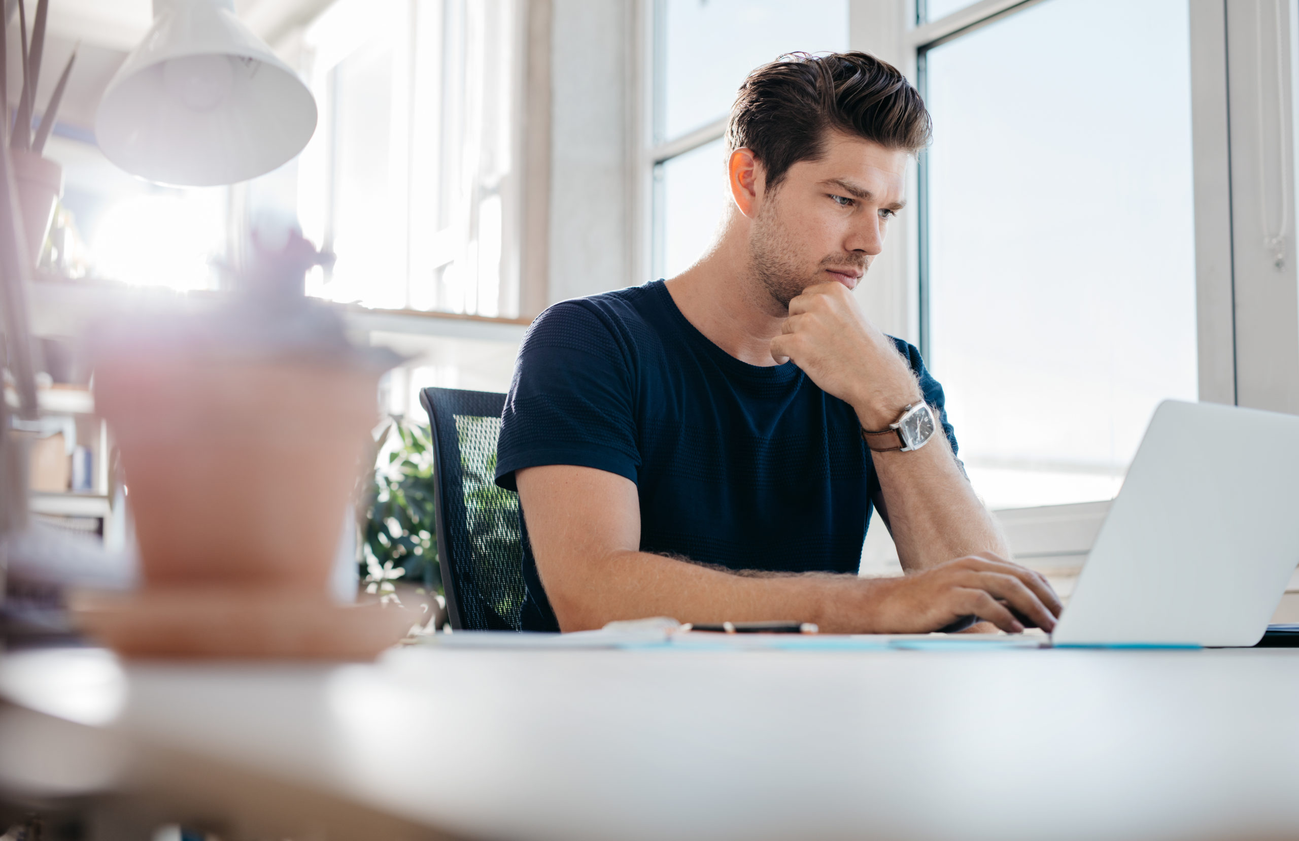 https://elements.envato.com/handsome-young-man-using-laptop-PEQGSFR