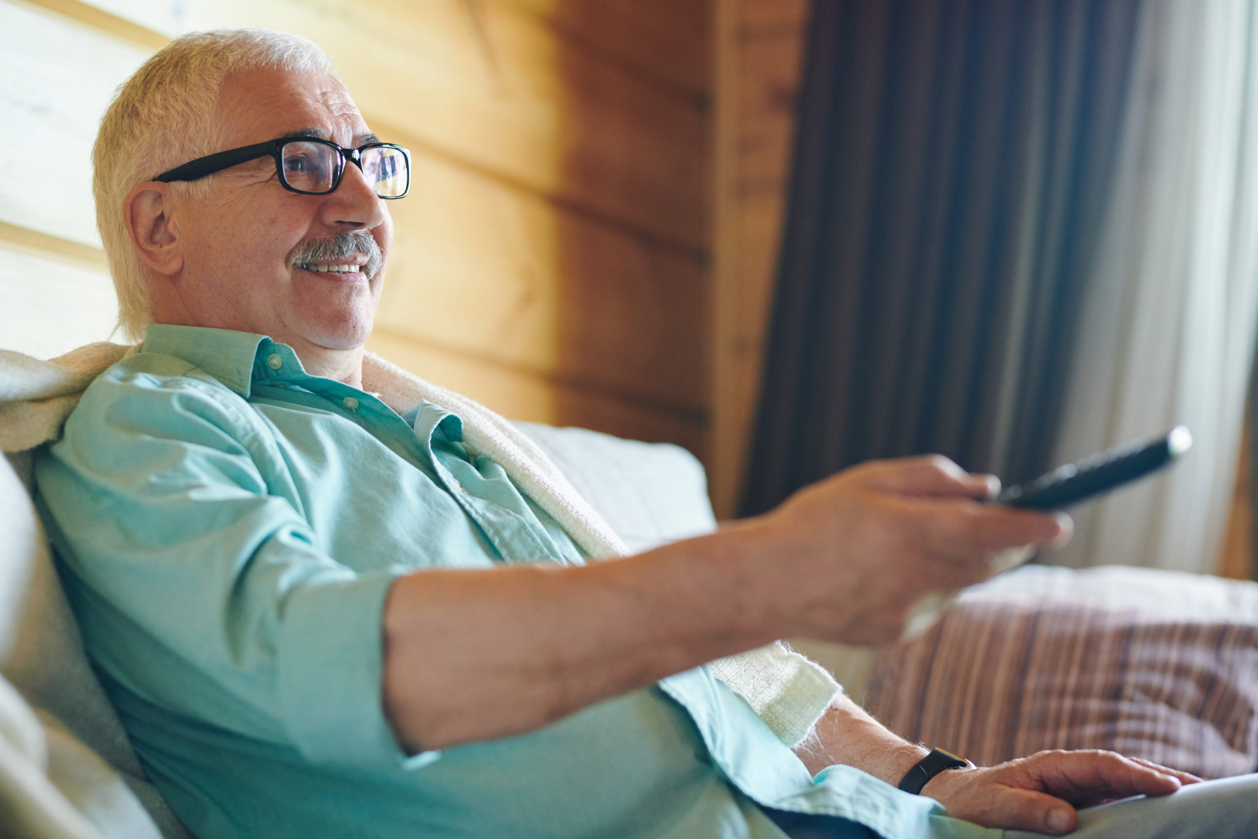 https://elements.envato.com/cheerful-senior-grey-haired-man-in-eyeglasses-and--NTBXY8K