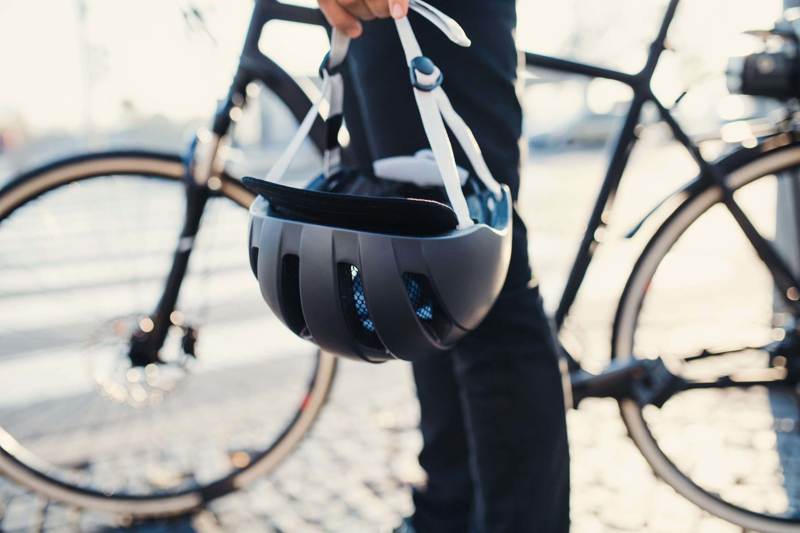 https://elements.envato.com/midsection-of-commuter-with-electric-bicycle-and-h-36U9C27