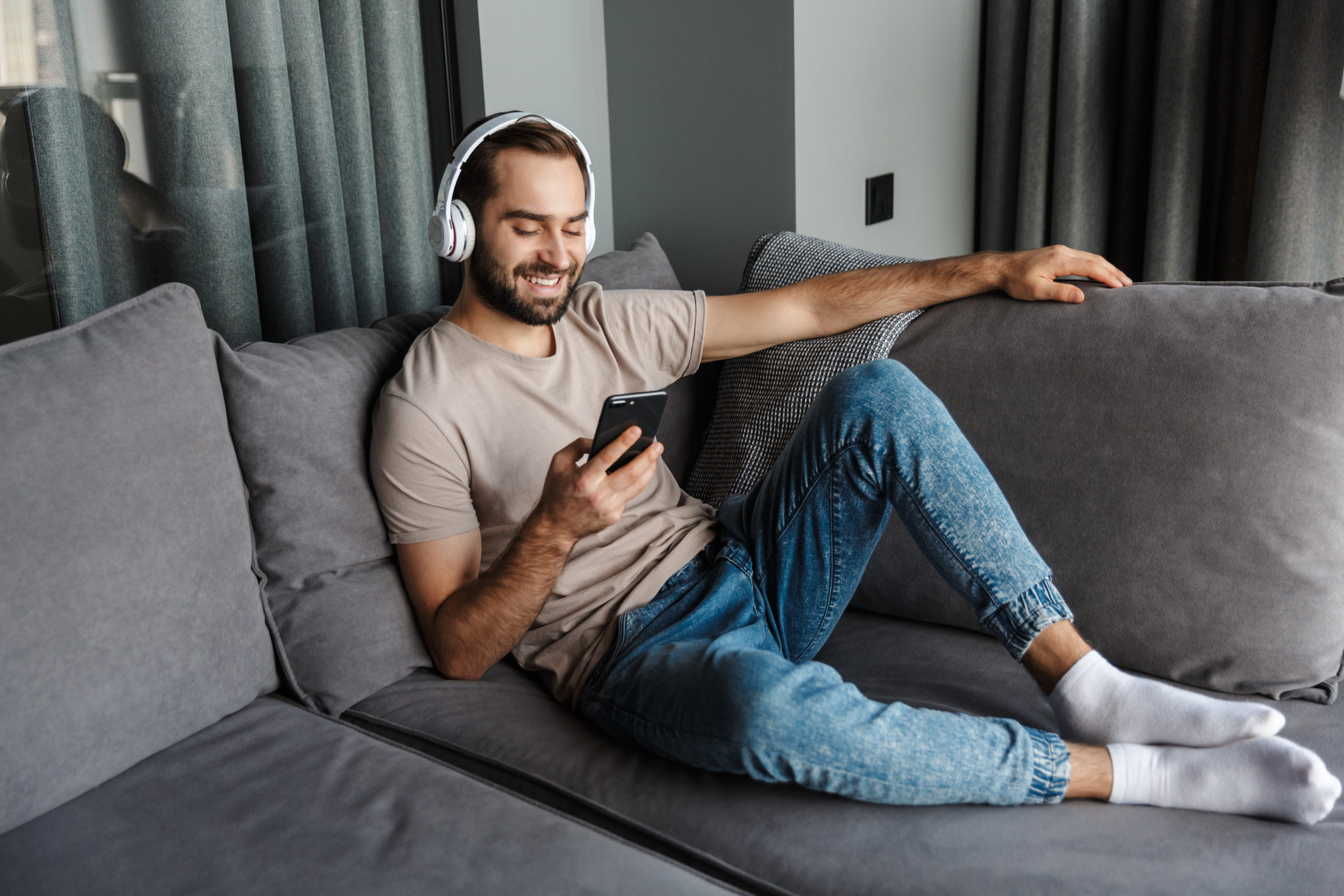 https://elements.envato.com/positive-man-listening-music-with-headphones-L52TLJL