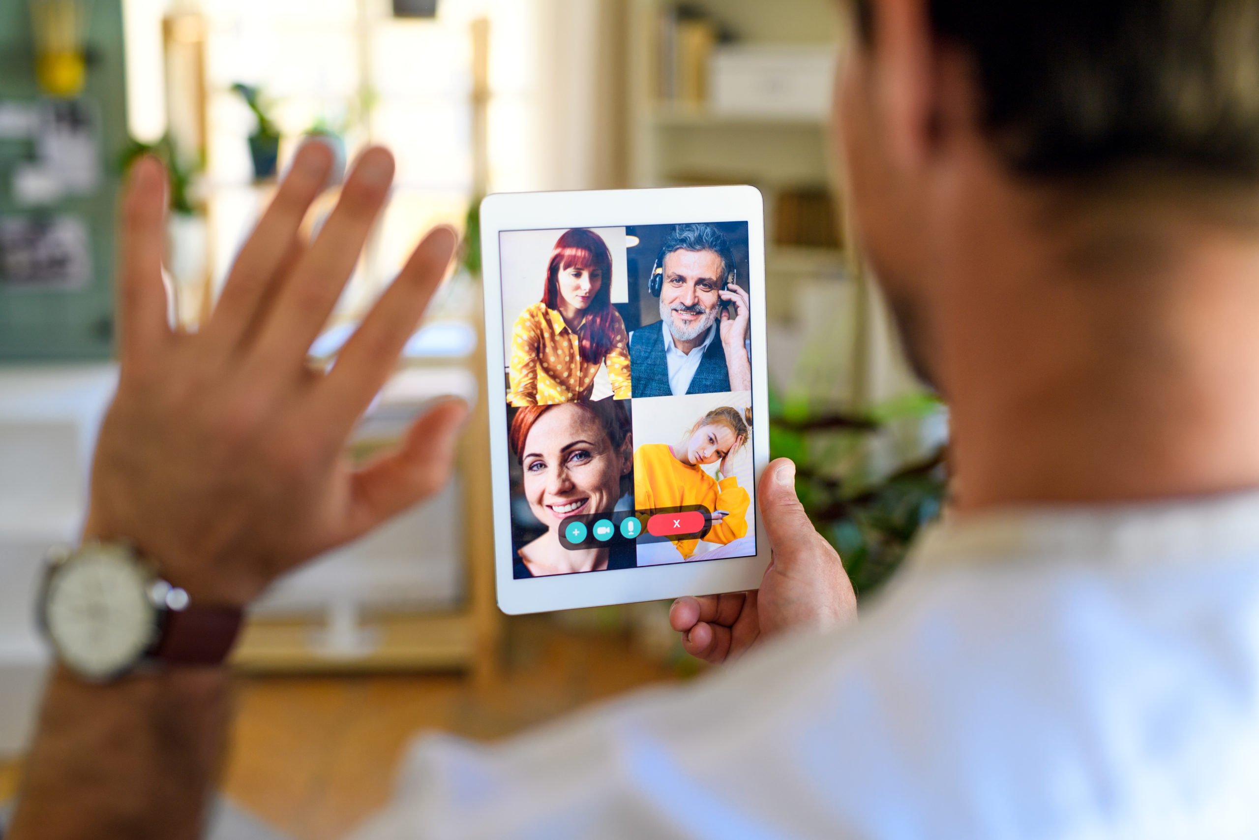 Airtime or Facetime App - What's the difference between the two?-https://elements.envato.com/rear-view-of-unrecognizable-man-having-video-call--22YYBCX