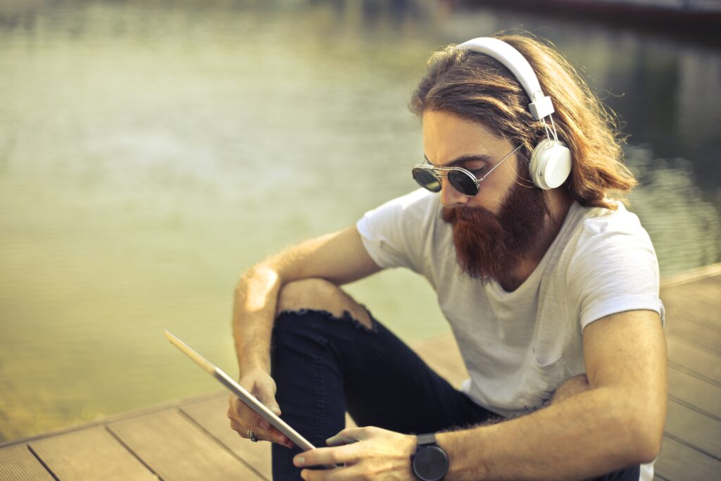 Man listening to music on tablet
