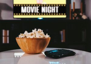 Popcorn on table in front of smart TV